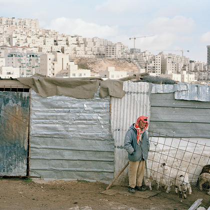 "Said Zawahari , 74. Palestinian Shepherd outside his home and small farm, overshadowed by the vast Jewish settlement of Har Homa, in the Palestinian West Bank.""12 years ago the hill in front of us was a forest. Seeing the huge Jewish settlement the"